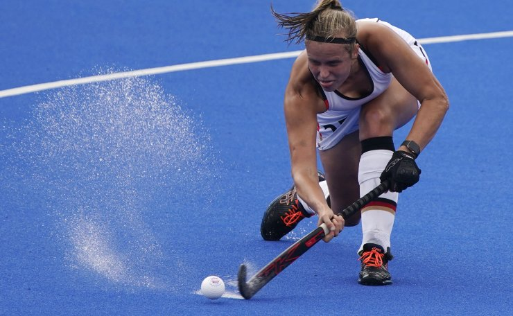 Germany's Viktoria Huse (25) passes against South Africa during a women's field hockey match at the 2020 Summer Olympics, Friday, July 30, 2021, in Tokyo, Japan. AP