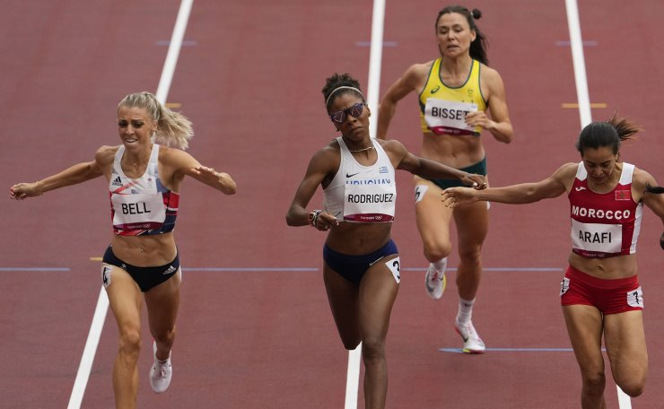 Rose Mary Almanza, right, of Cuba, wins a heat in the women's 800-meter run at the 2020 Summer Olympics, Friday, July 30, 2021, in Tokyo. AP