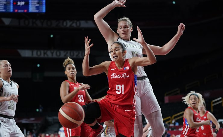 Puerto Rico's Michelle Gonzalez (91) looses the ball in front of Belgium's Kyara Linskens (13) during women's basketball preliminary round game at the 2020 Summer Olympics, Friday, July 30, 2021, in Saitama, Japan. AP