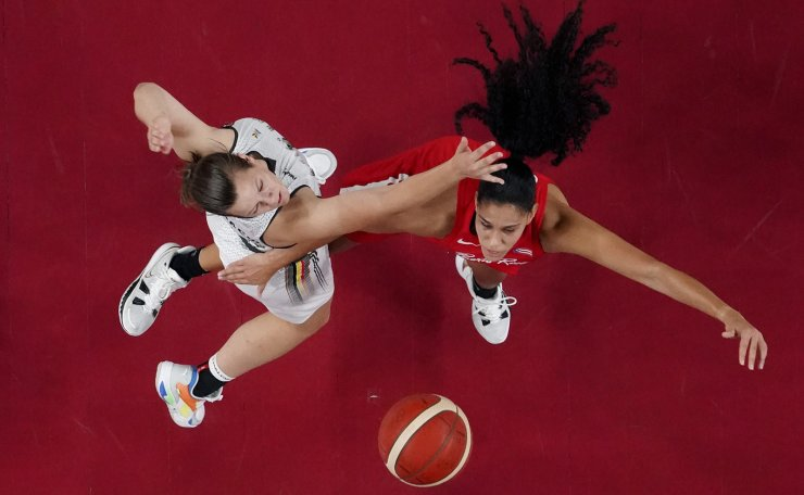 Puerto Rico's Isalys Quinones, right, shoots past Belgium's Billie Massey, left, during a women's basketball game at the 2020 Summer Olympics, Wednesday, July 28, 2021, in Saitama, Japan. AP