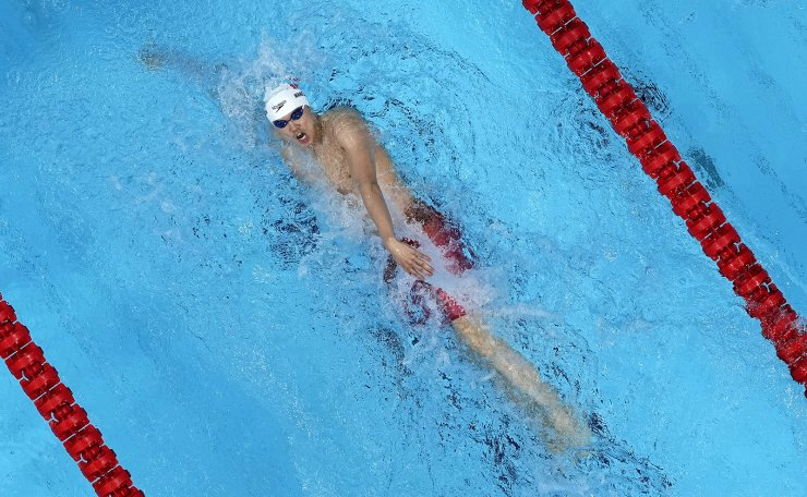 Wang Shun, of China, swims to victory in the men's 200m individual medley final wins the men's 200m individual medley final at the 2020 Summer Olympics, Friday, July 30, 2021, in Tokyo, Japan. AP