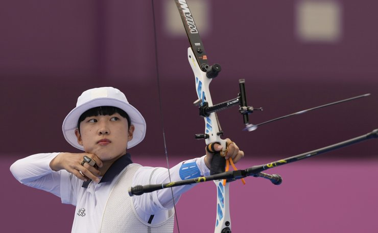 South Korea's An San looks at her bow during her individual elimination match against Japan's Ren Hayakawa, at the 2020 Summer Olympics, Friday, July 30, 2021, in Tokyo, Japan. AP