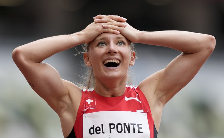 Ajla Del Ponte, of Switzerland, reacts after a heat in the women's 100-meter run at the 2020 Summer Olympics, Friday, July 30, 2021, in Tokyo. AP
