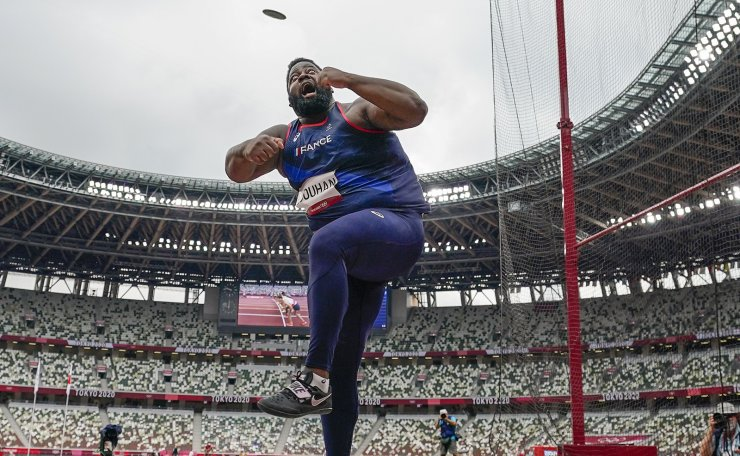Lolassonn Djouhan, of France, competes in his heat of the men's discus throw at the 2020 Summer Olympics, Friday, July 30, 2021, in Tokyo. AP
