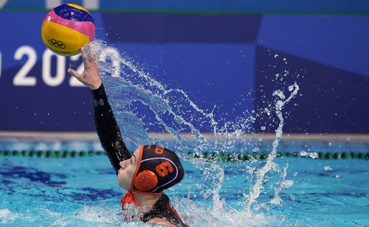 Netherland's Nomi Stomphorst passes the ball during a preliminary round women's water polo match against South Africa at the 2020 Summer Olympics, Friday, July 30, 2021, in Tokyo, Japan. AP