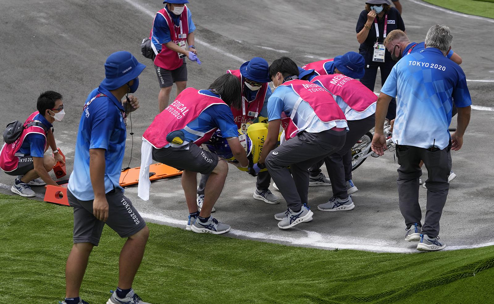 Saya Sakakibara of Australia is stretchered away by medics after crashing in the women's BMX Racing semifinals at the 2020 Summer Olympics, Friday, July 30, 2021, in Tokyo, Japan. AP