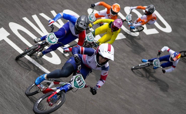Bethany Shriever of Britain, center, who won gold, is followed by Axelle Etienne of France, left, in the women's BMX Racing semifinals at the 2020 Summer Olympics, Friday, July 30, 2021, in Tokyo, Japan. AP