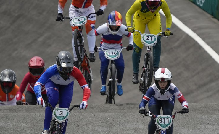 Bethany Shriever of Britain, who won gold, center, is followed by Axelle Etienne of France, left, in the women's BMX Racing semifinals at the 2020 Summer Olympics, Friday, July 30, 2021, in Tokyo, Japan. AP