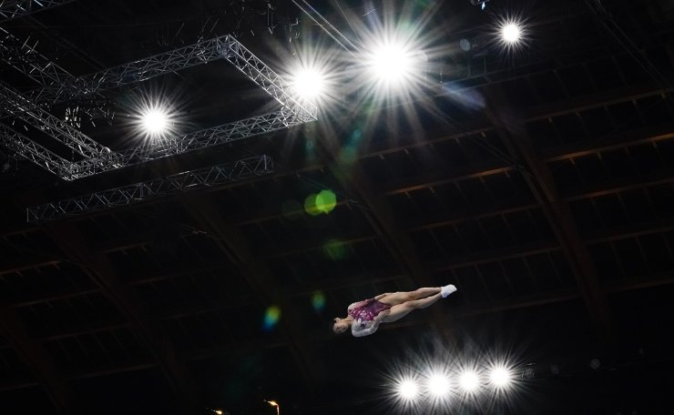 Megu Uyama, of Japan, competes in the women's trampoline gymnastics final at the 2020 Summer Olympics, Friday, July 30, 2021, in Tokyo. AP