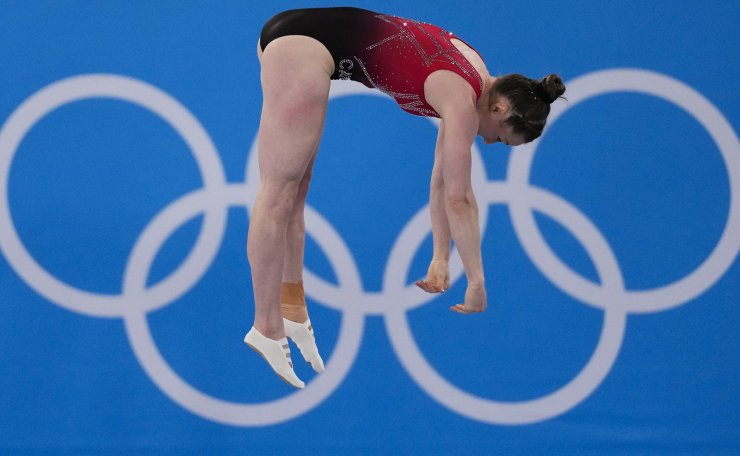 Rosannagh Maclennan, of Canada, competes in the women's trampoline gymnastics qualifiers at the 2020 Summer Olympics, Friday, July 30, 2021, in Tokyo. AP