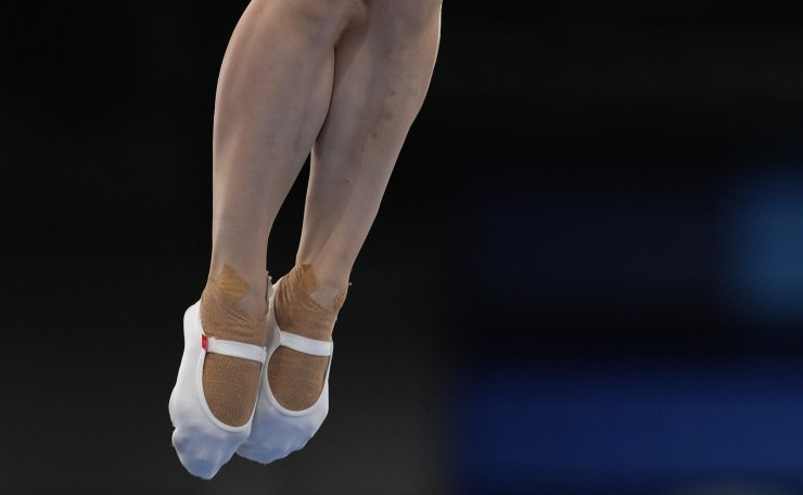 Lingling Liu, of China, performs in a women's trampoline gymnastics qualifier at the 2020 Summer Olympics, Friday, July 30, 2021, in Tokyo. AP