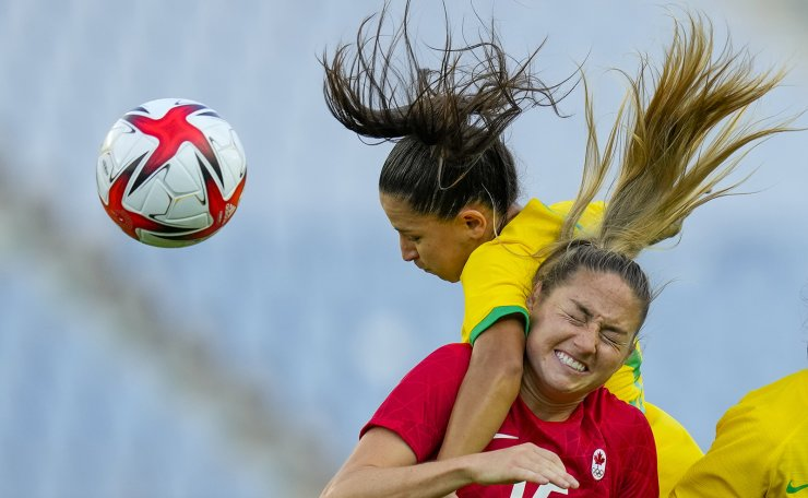 Brazil's Debinha, left, and Canada's Janine Beckie go for a header during a women's quarterfinal soccer match at the 2020 Summer Olympics, Friday, July 30, 2021, in Rifu, Japan. AP