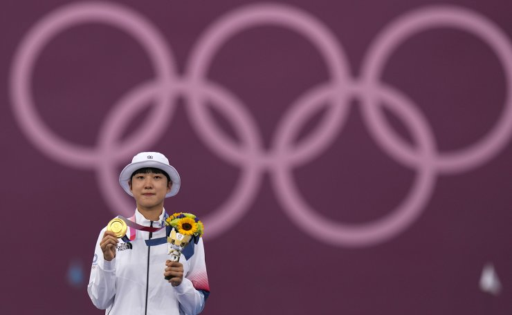 First placed South Korea's An San celebrates on the podium of the women's individual competition at the 2020 Summer Olympics, Friday, July 30, 2021, in Tokyo, Japan. AP