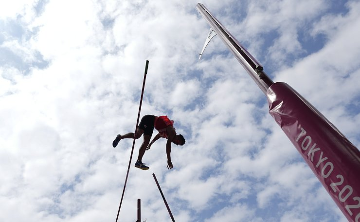 Seito Yamamoto, of Japan, competes during the qualification round of the men's pole vault at the 2020 Summer Olympics, Saturday, July 31, 2021, in Tokyo. AP