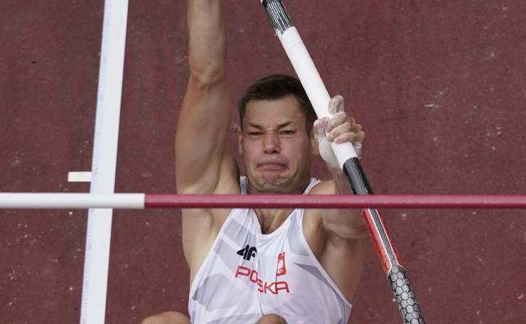 Pawel Wojciechowski, of Poland, competes during a qualifications round in the men's pole vault at the 2020 Summer Olympics, Saturday, July 31, 2021, in Tokyo. AP