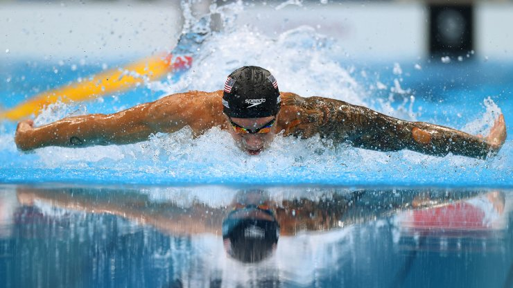 Tokyo 2020 Olympics - Swimming - Men's 100m Butterfly - Medal Ceremony - Tokyo Aquatics Centre - Tokyo, Japan - July 31, 2021. Caeleb Dressel of the United States in action REUTERS