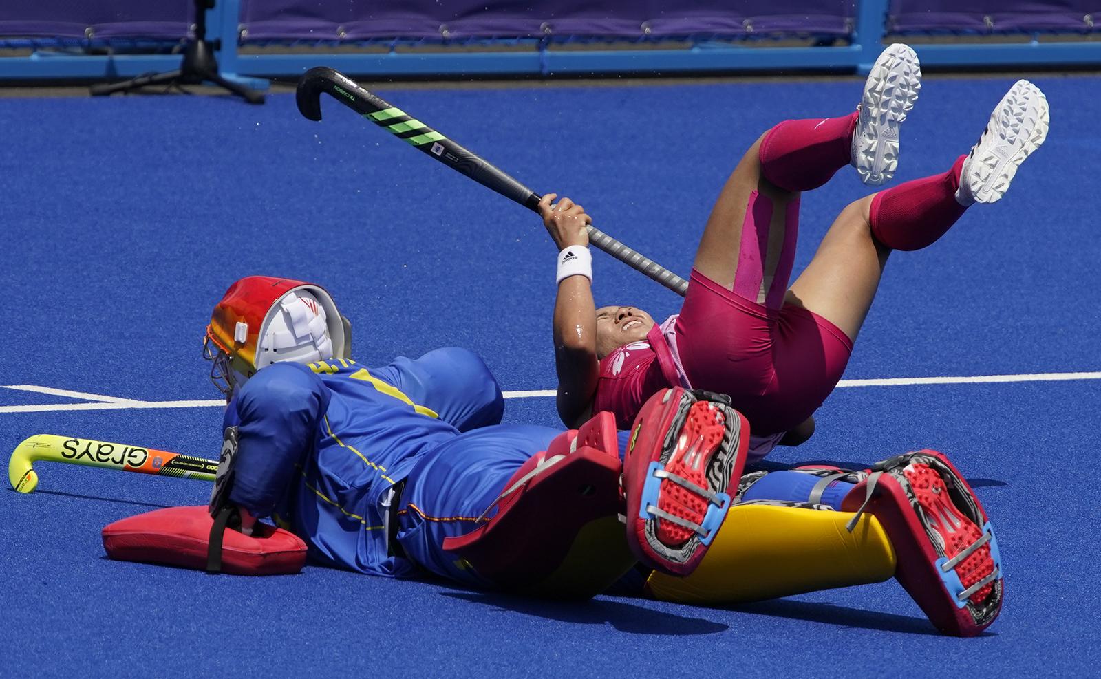 Spain's goalkeeper Maria de los Angeles Ruiz Castillo (1) blocks a shot attempt by Japan's Yuri Nagai (9) during a women's field hockey match at the 2020 Summer Olympics, Saturday, July 31, 2021, in Tokyo, Japan. AP
