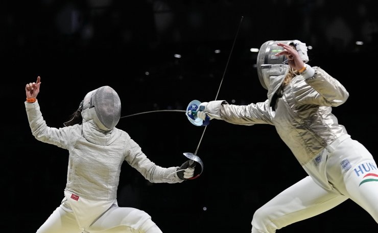 Kim Jiyeon of South Korea, left, and Ainna Marton of Hungary compete in the women's Sabre team quarterfinal at the 2020 Summer Olympics, Saturday, July 31, 2021, in Chiba, Japan. AP