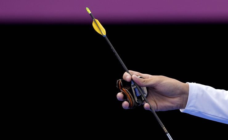 Taiwan's Tang Chih-Chun takes an arrow during his men's individual eliminations match against Israel's Itay Shanny at the 2020 Summer Olympics, Saturday, July 31, 2021, in Tokyo, Japan. AP