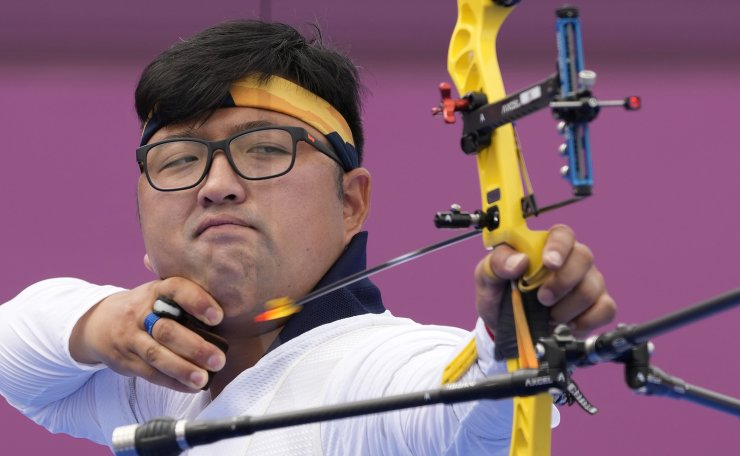 South Korea's Kim Woojin shoots an arrow during the men's individual eliminations at the 2020 Summer Olympics, Saturday, July 31, 2021, in Tokyo, Japan. AP