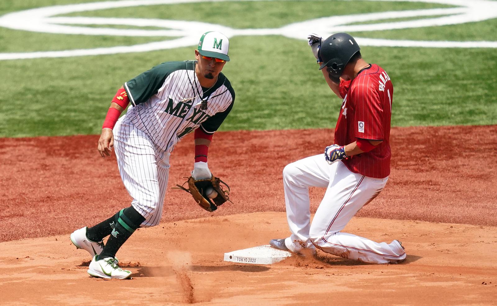 Japan's Tetsuto Yamada, right, steals second base past Mexico's Ramiro Pena during a baseball game at Yokohama Baseball Stadium during the 2020 Summer Olympics, Saturday, July 31, 2021, in Yokohama, Japan. AP