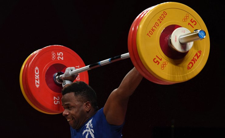 Cuba's Olfides Saez Vera competes in the men's 96kg weightlifting competition during the Tokyo 2020 Olympic Games at the Tokyo International Forum in Tokyo on July 31, 2021. AFP