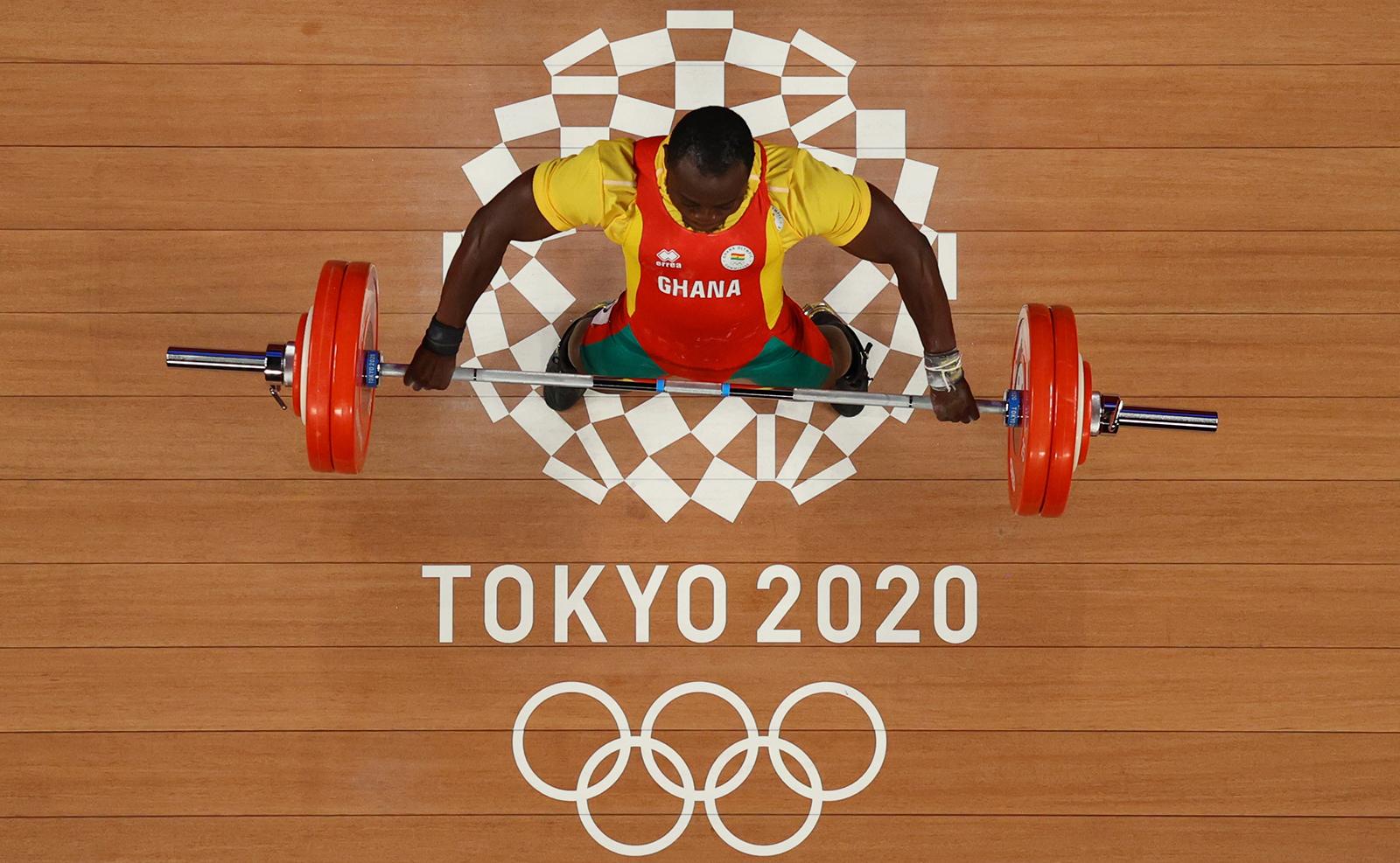 Tokyo 2020 Olympics - Weightlifting - Men's 96kg - Group B - Tokyo International Forum, Tokyo, Japan - July 31, 2021. Christian Amoah of Ghana in action. REUTERS