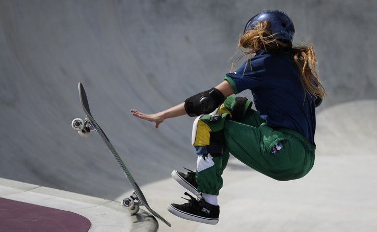 Yndiara Asp of Brazil reaches out as she loses the board as she takes part in a women's Park Skateboarding training session at the 2020 Summer Olympics, Saturday, July 31, 2021, in Tokyo, Japan. AP