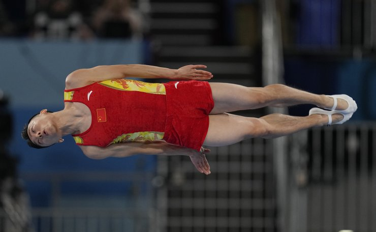 Dong Dong, of China, competes in the men's trampoline gymnastics final at the 2020 Summer Olympics, Saturday, July 31, 2021, in Tokyo. AP
