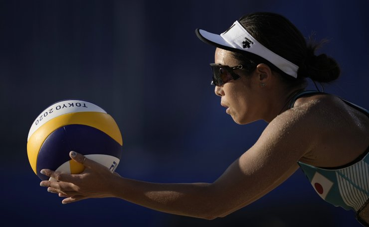 Megumi Murakami, of Japan, prepares to serve during a women's beach volleyball match against Spain at the 2020 Summer Olympics, Saturday, July 31, 2021, in Tokyo, Japan. AP