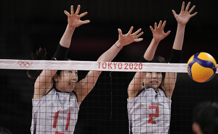 Japan's Erika Shinomiya, left, and Sarina Koga, block a ball during a women's volleyball preliminary round pool A match against South Korea, at the 2020 Summer Olympics, Saturday, July 31, 2021, in Tokyo, Japan. AP