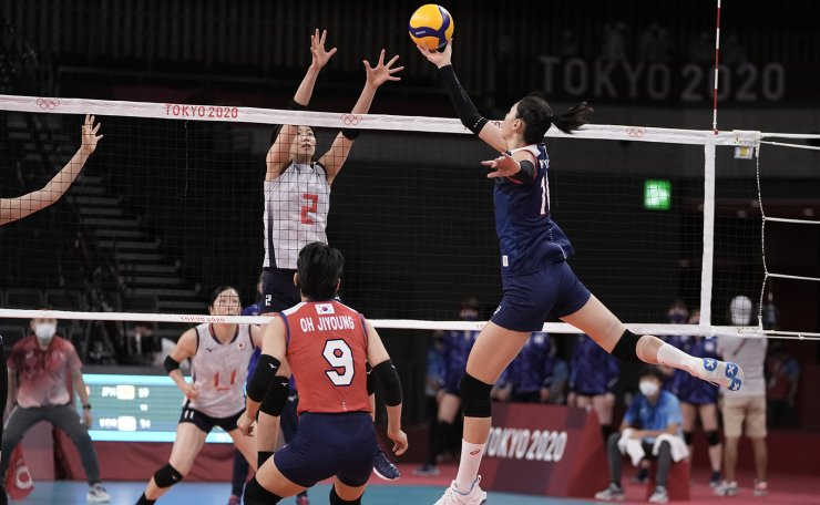 Japan's Sarina Koga tries to block a shot by South Korea's Kim Su-ji, during a women's volleyball preliminary round pool A match, at the 2020 Summer Olympics, Saturday, July 31, 2021, in Tokyo, Japan. AP