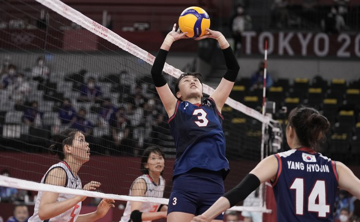 South Korea's Yeum Hye-seon sets a ball during a women's volleyball preliminary round pool A match against South Korea, at the 2020 Summer Olympics, Saturday, July 31, 2021, in Tokyo, Japan. AP