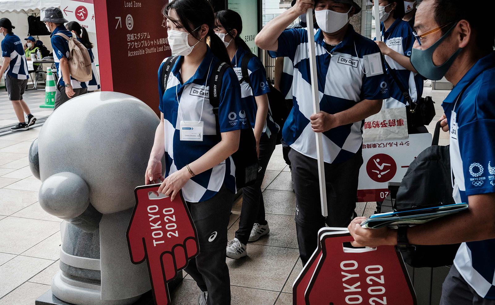 Volunteers of Miyagi city start working at Sendai station in Miyagi on July 31, 2021. AFP