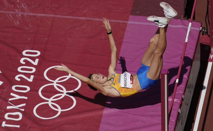 Yaroslava Mahuchikh, of Ukraine, competes during a qualification round of the women's high jump at the 2020 Summer Olympics, Thursday, Aug. 5, 2021, in Tokyo. AP