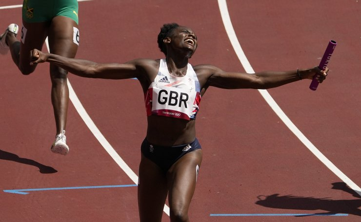 Daryll Neita, of Britain celebrates after anchoring the team to a win in a semifinal of the women's 4 x 100-meter relay at the 2020 Summer Olympics, Thursday, Aug. 5, 2021, in Tokyo, Japan. AP
