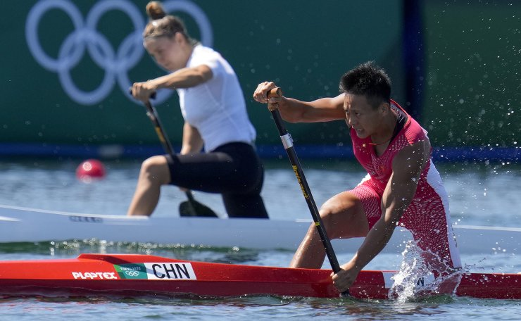Lin Wenjun of China competes in the women's canoe single 200m semifinal at the 2020 Summer Olympics, Thursday, Aug. 5, 2021, in Tokyo, Japan. AP
