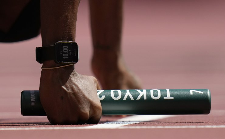 A competitor prepares to start a semifinal of the women's 4 x 100-meter relay at the 2020 Summer Olympics, Thursday, Aug. 5, 2021, in Tokyo, Japan. AP