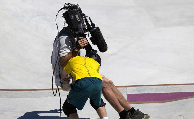 Kieran Woolley of Australia crashes in to a cameraman during the men's park skateboarding prelims at the 2020 Summer Olympics, Thursday, Aug. 5, 2021, in Tokyo, Japan. AP