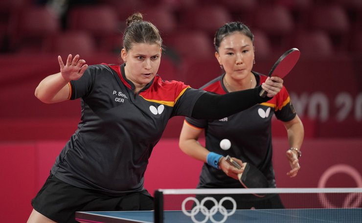 Germany's Petrissa Solja, left, and Shan Xiaona compete during the table tennis women's team bronze medal match against Hong Kong's Doo Hoi-kem and Lee Ho-ching at the 2020 Summer Olympics, Thursday, Aug. 5, 2021, in Tokyo. AP