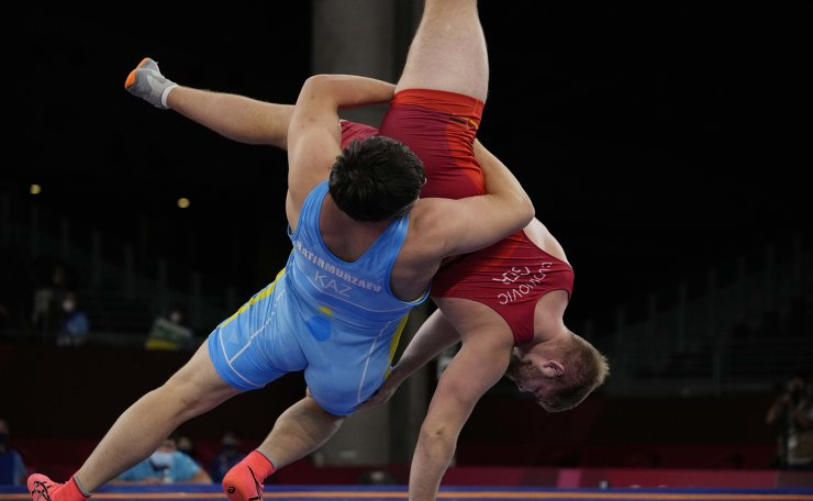Germany's Gennadij Cudinovic compete with Kazahstan's Yusup Batirmurzaev during the men's 125kg Freestyle wrestling repechage match at the 2020 Summer Olympics, Thursday, Aug. 5, 2021, in Tokyo, Japan. AP