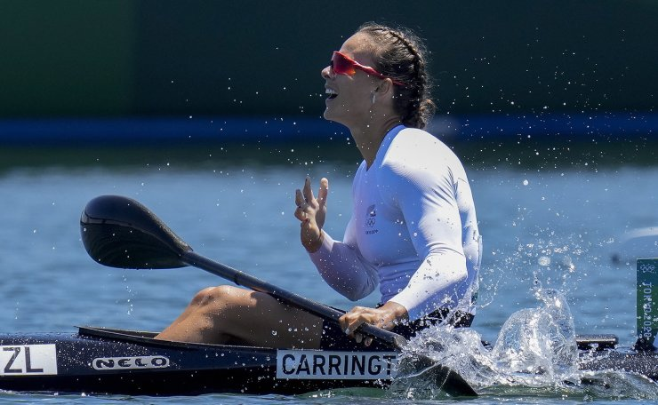 Lisa Carrington, of New Zealand, reacts after winning the gold medal in the women's kayak single 500m final at the 2020 Summer Olympics, Thursday, Aug. 5, 2021, in Tokyo, Japan. AP