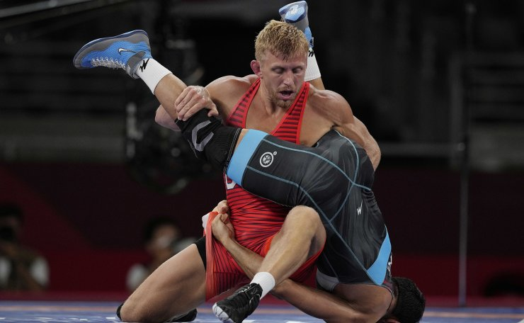 United State's Kyle Douglas Dake compete with Iran's Mostafa Hosseinkhani during the men's 74kg Freestyle wrestling eight final match at the 2020 Summer Olympics, Thursday, Aug. 5, 2021, in Tokyo, Japan. AP