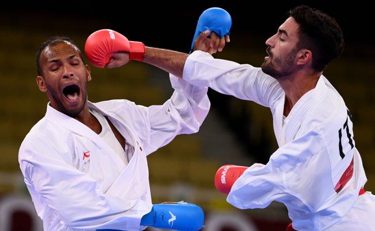 Tokyo 2020 Olympics - Karate - Men's -67kg Kumite - Pool B - Nippon Budokan, Tokyo, Japan - August 5, 2021. Angelo Crescenzo of Italy in action against Andres Madera of Venezuela. REUTERS