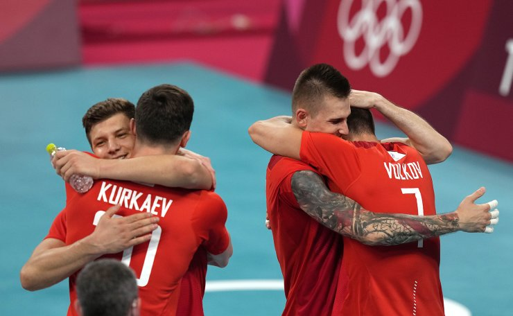 Russian teammates celebrate winning the men's volleyball semifinal match between Brazil and Russian Olympic Committee at the 2020 Summer Olympics, Thursday, Aug. 5, 2021, in Tokyo, Japan. AP