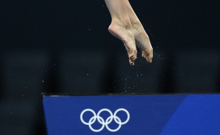 Iuliia Timoshinina of Russian Olympic Committee competes in women's diving 10m platform final at the Tokyo Aquatics Centre at the 2020 Summer Olympics, Thursday, Aug. 5, 2021, in Tokyo, Japan. AP