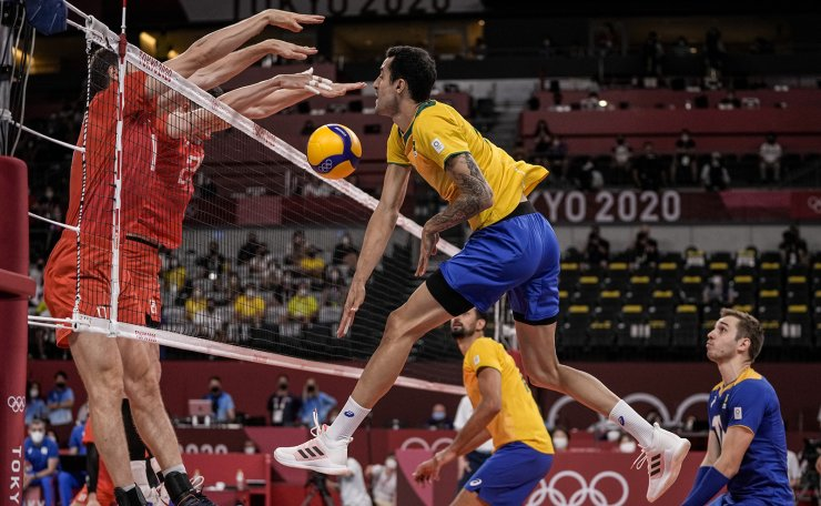 Brazil's Douglas Correia De Souza spikes the ball during the men's volleyball semifinal match between Brazil and Russian Olympic Committee at the 2020 Summer Olympics, Thursday, Aug. 5, 2021, in Tokyo, Japan.