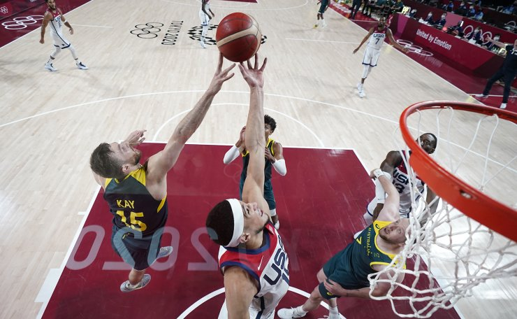 Australia's Nic Kay (15) fights for a rebound with United States's Devin Booker during a men's basketball semifinal round game at the 2020 Summer Olympics, Thursday, Aug. 5, 2021, in Saitama, Japan. AP