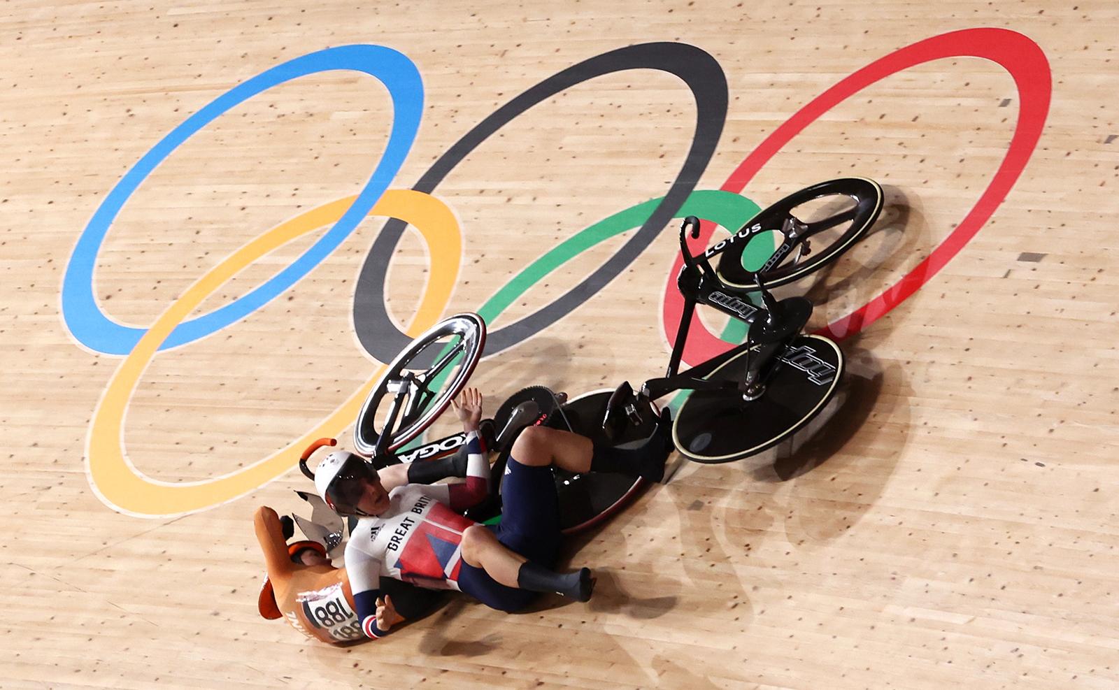 Tokyo 2020 Olympics - Cycling - Track - Women's Keirin - Quarterfinal - Izu Velodrome, Shizuoka, Japan - August 5, 2021.  Laurine van Riessen of the Netherlands and Katy Marchant of Britain crash. REUTERS