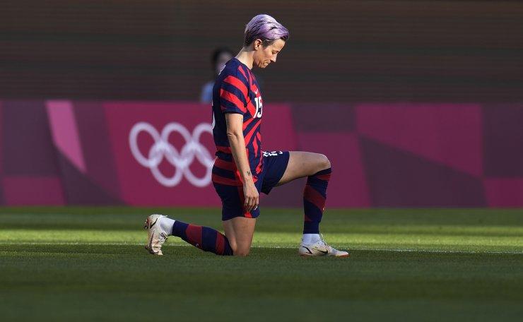 United States' Megan Rapinoe kneels prior to the women's bronze medal soccer match against Australia at the 2020 Summer Olympics, Thursday, Aug. 5, 2021, in Kashima, Japan. AP